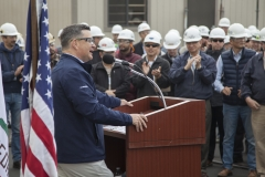 Kevin Graney, President of General Dynamics NASSCO, addresses a crowd of shipbuilders as the company commissioned a new panel line in the San Diego shipyard.