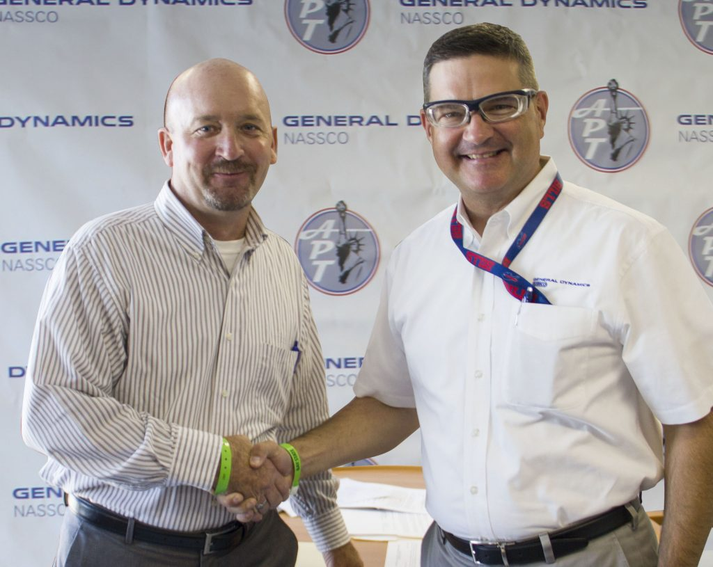 dave-farrell-project-manager-for-american-petroleum-tankers-and-kevin-graney-vice-president-and-general-manager-for-general-dynamics-nassco-make-the-delivery-of-the-garden-state-official