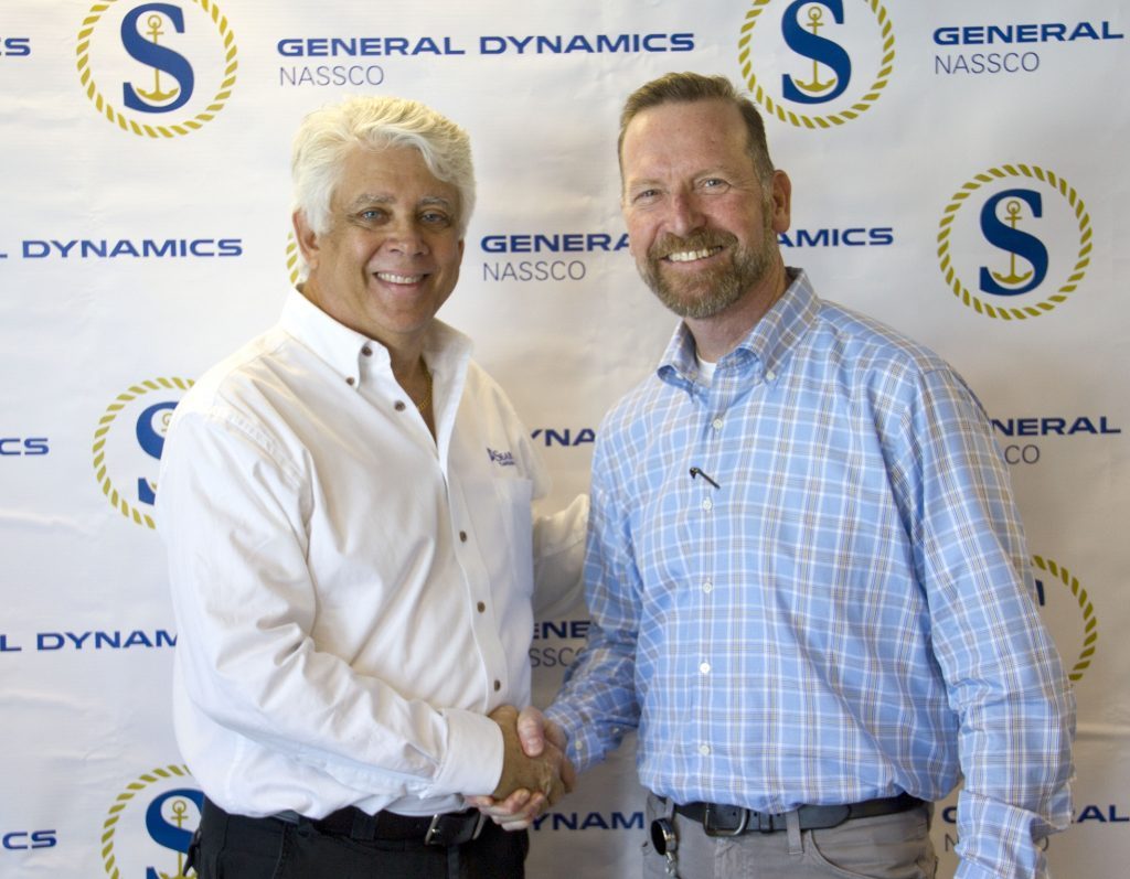 Tom Denning, of SEA-Vista LLC, and Bill Cuddy for General Dynamics NASSCO, make the delivery of the Constitution official.